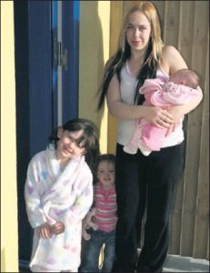 Eleanor Russell with her three girls - Leah, Erin and Jenna pictured outside their new home.